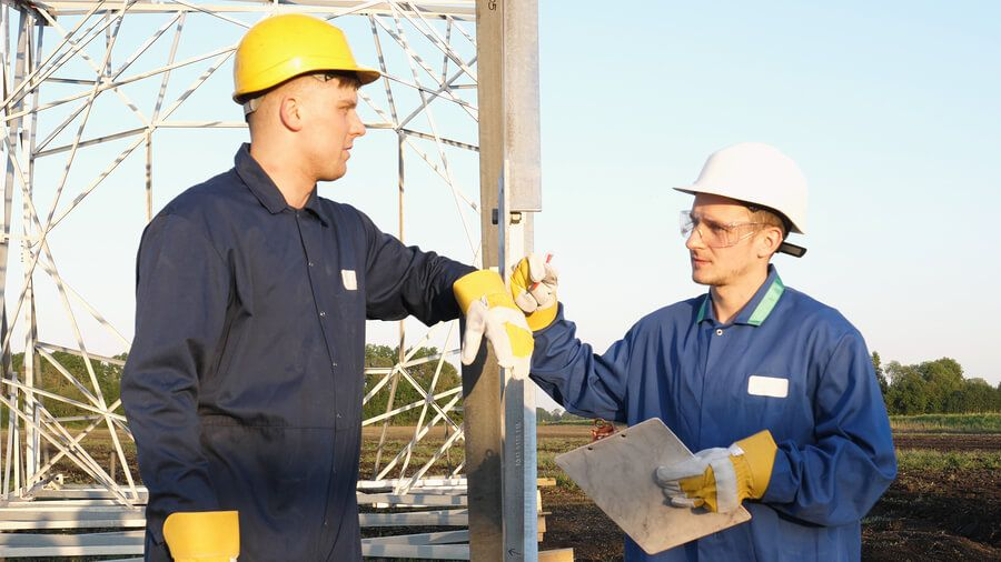Construction worker and foreman discussing a construction project
