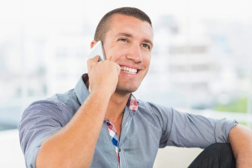 Male receptionist answering a general contracting call